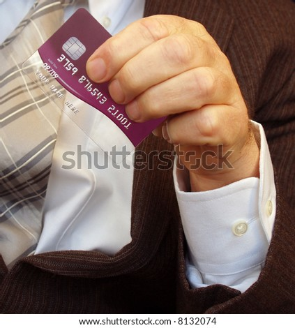 Credit card being waved in a gentle manner - stock photo