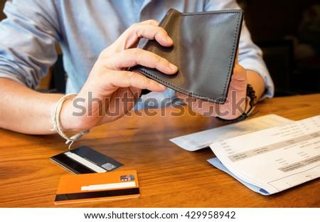 credit card debt - pour empty wallet. - stock photo