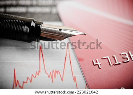 Credit card,  fountain pen and diagram.  - stock photo