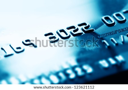 Credit card in blue tone. Selective focus. - stock photo