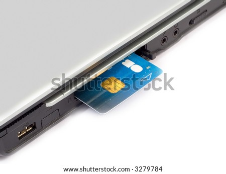 Credit card inserted in laptop - Concept for Internet Banking & Shopping - stock photo
