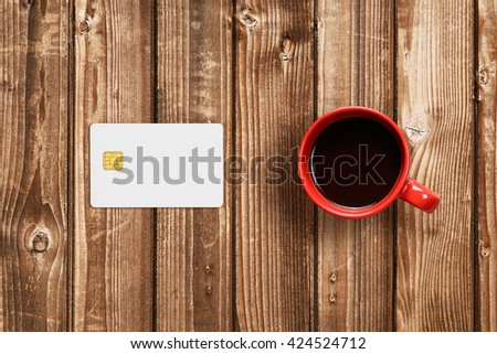 Credit card mockup and coffee cup - stock photo