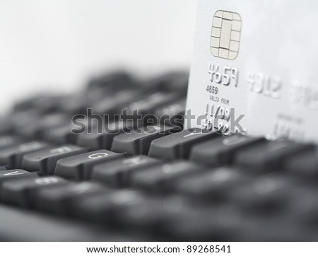 Credit card on computer keyboard with shallow depth of field - stock photo