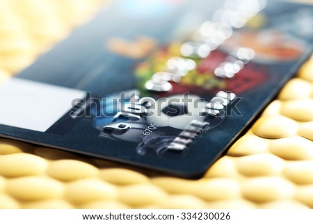 Credit card on golden background, close up - stock photo