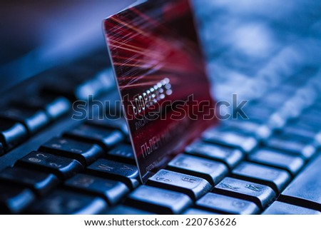 Credit card on keyboard. Online banking. - stock photo