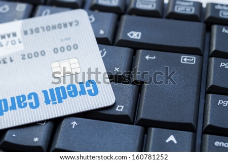 credit card on keyboard with microchip, e-commerce concept - stock photo