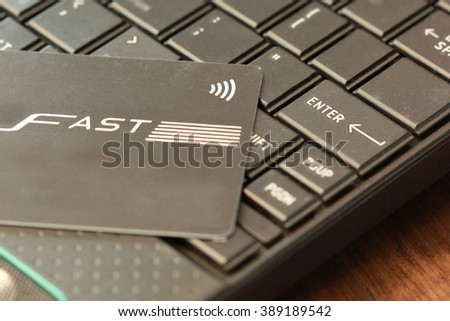 Credit card on laptop keyboard