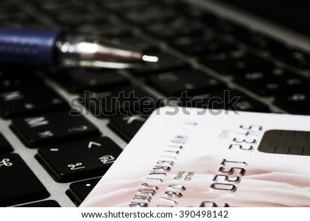 Credit Card on Laptop (selective focus and lowkey) - stock photo