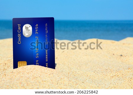 credit card on the beach. sky and sea as a background - stock photo