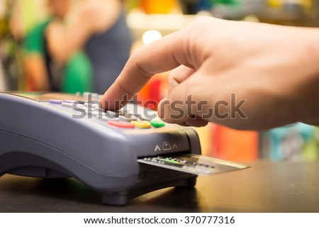 Credit Card Payment, Buy And Sell Products & Service With Clothing Store In Background - stock photo