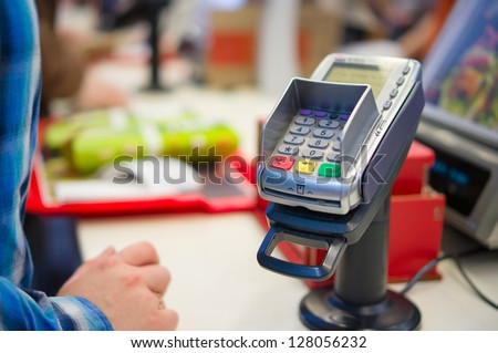 Credit Card payment Terminal in restaurant - stock photo
