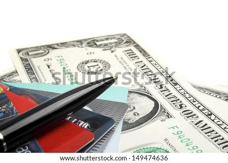 Credit card, pen and money closeup - stock photo