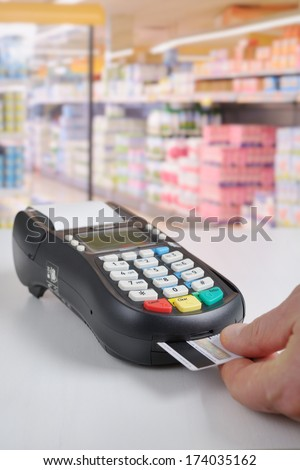 Credit card reader in action - stock photo