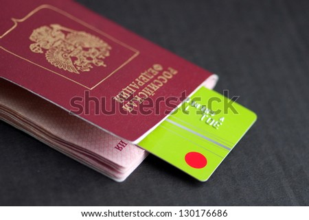 credit cards and passport on a dark background