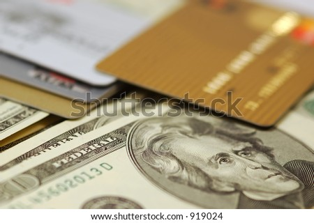 Credit Cards atop Paper Money - stock photo