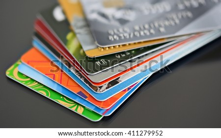 Credit cards in shallow focus. Credit card on black background. Closer-Up Credit card. Credit Card with chip. Credit cards for payment. Several credit cards. Credit card number.  - stock photo