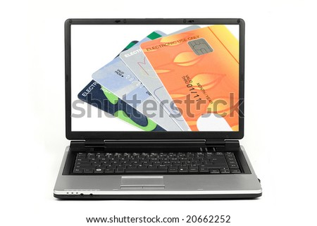 Credit cards isolated on laptop screen on white background