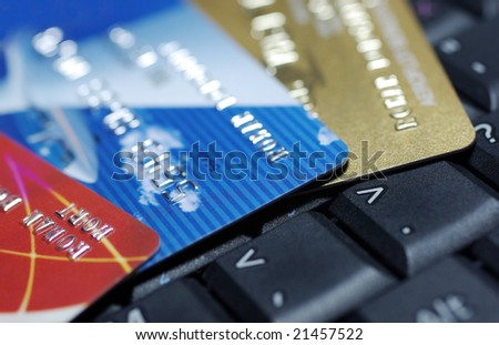 Credit cards laying laptop keyboard. Credit card keyboard close up. Credit card laptop key. Credit card blue, red, golden. Credit card macro. Credit cards notebook keyboard. Credit card shop payment.