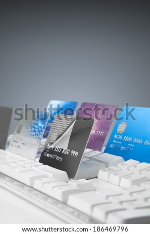 Credit cards on a computer keyboard, - stock photo