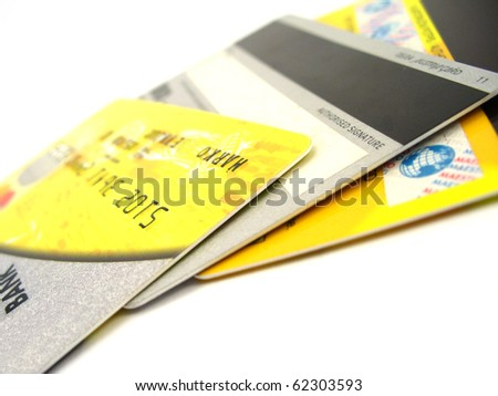 Credit Cards on white background, yellow - stock photo