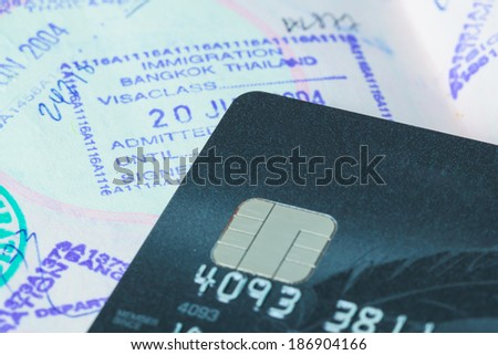 credit cards with sim and passport stamp for travel concept background
