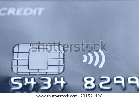 Credit contactless card with secured chip. Macro shot, selective focus