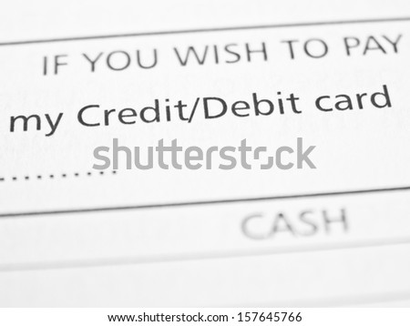 CREDIT/DEBIT CARD written on a form or contract close up.