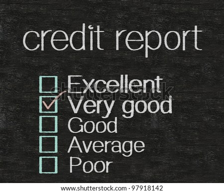 credit report written with rate on blackboard background