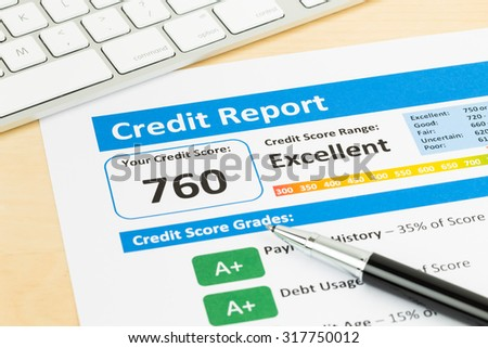 Credit score report with keyboard - stock photo