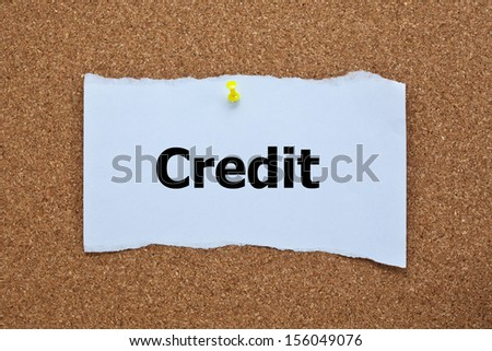 Credit Word on Torn Paper, Corkboard - stock photo