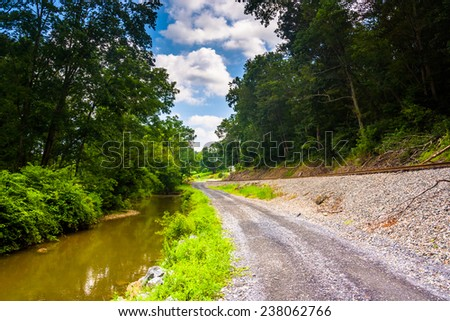 Creek and railroad track along a dirt road in Baltimore County, Maryland.