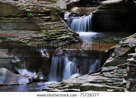 creek closeup in woods with rocks and stream in Watkins Glen state park in New York State - stock photo
