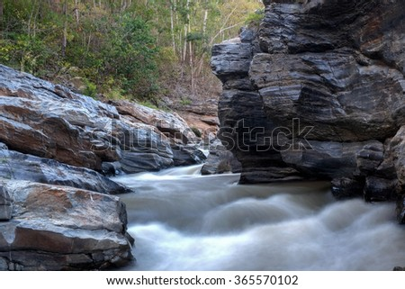 creek flowing over the rocks - stock photo