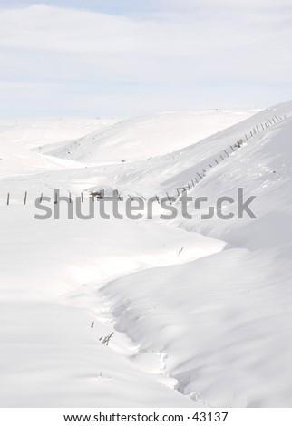 Creek through Snow Field - stock photo