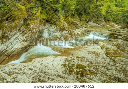 Creek with clear water in the small canyon. - stock photo