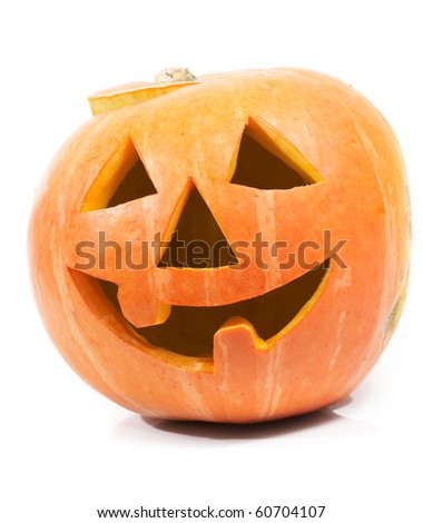 Creepy carved pumpkin face, with a smile - stock photo