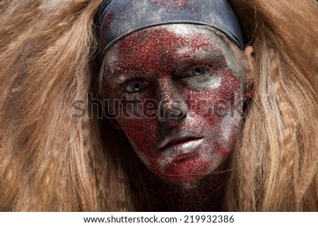 Creepy female demon with face art