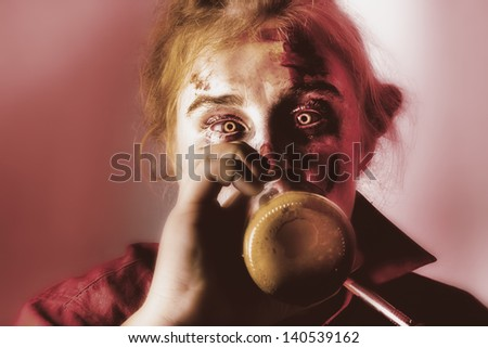 Creepy portrait of a drunken female ghoul drinking beer at Halloween party event - stock photo
