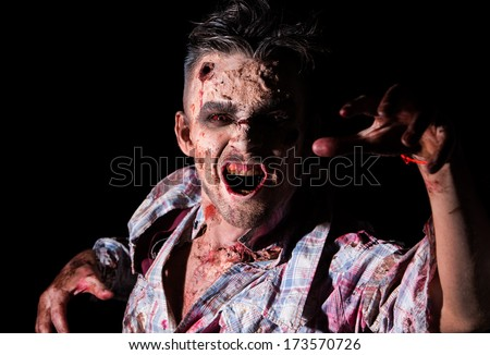 Creepy zombie on a black background