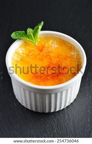 Creme brulee.French vanilla cream dessert with caramelised sugar on top. - stock photo