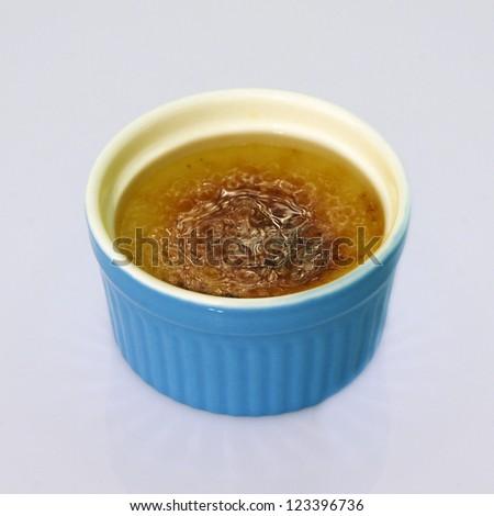 Creme Brulee in Blue Ramekin - stock photo