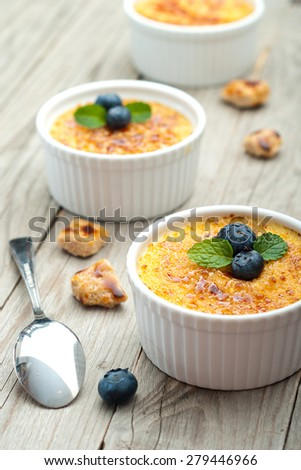 Creme Brulee With Blueberries and mint garnish - stock photo