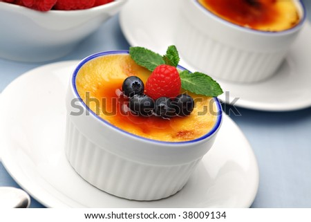 Creme Brulee with fresh berry fruits - stock photo