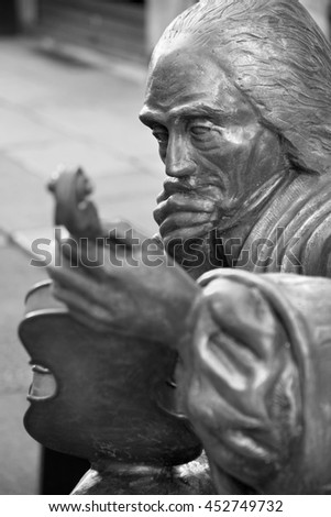 CREMONA, ITALY - MAY 24, 2016: The detail of bronze statue of Antonio Stradivari in front of his birth house by unknown artist of 21. cent.
