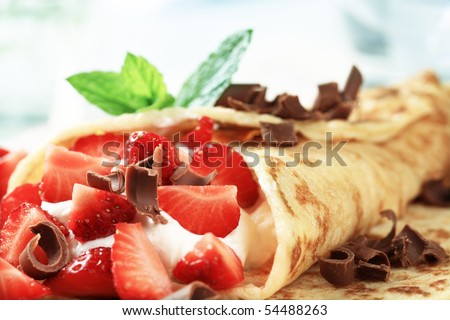 Crepe with strawberries - stock photo