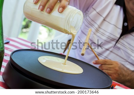 Creperie buffet with a chef preparing a crepe (pancake) - stock photo