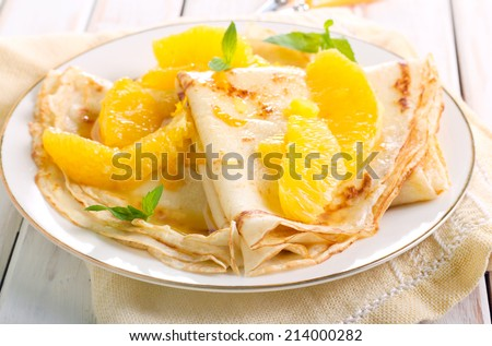 Crepes Suzette - thin pancakes with orange sauce, selective focus - stock photo
