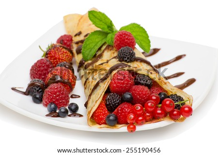Crepes With Berries and cup of coffee .Crepe with Strawberry, Raspberry, Blueberry and Chocolate topping.Pancake - stock photo