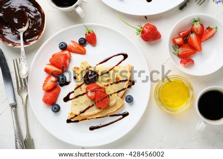 crepes with berries and sauce, food - stock photo