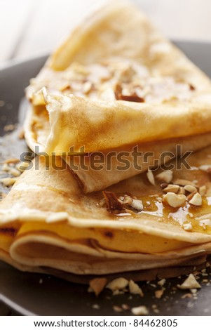 crepes with honey or syrup and roasted nuts